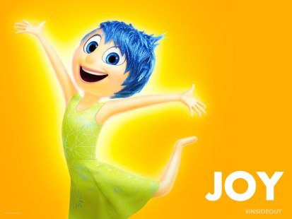 According to Pixar, Joy was modeled after a star: slim, pointy and bright. She even glows. This is because she's the star of Riley's head and the leader of her emotions. her look has nothing to do with her being rich or whatever. She's a freaking EMOTION. They all reside together inside a kid's head.